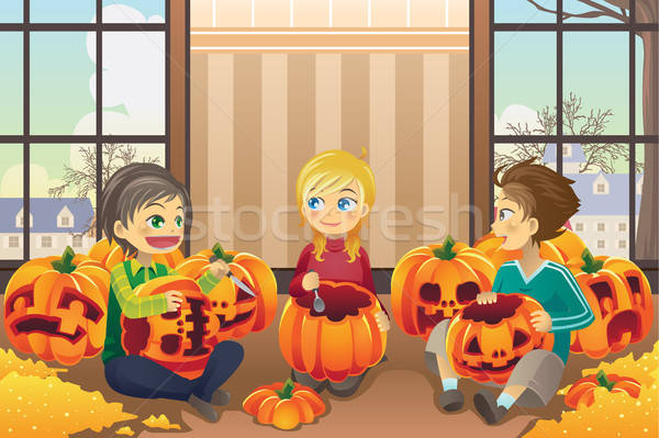 Kids carving pumpkins Stock photo © artisticco
