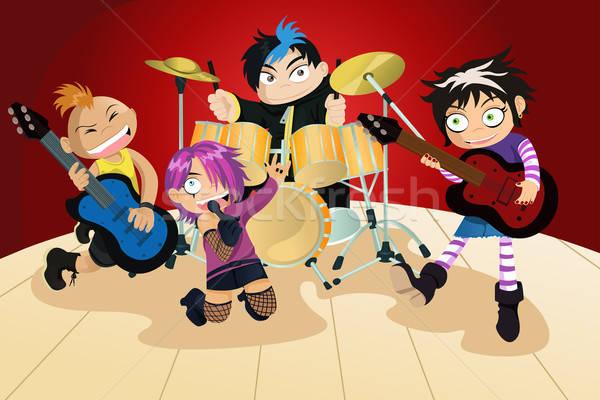 Rock band quattro piccolo ragazzi musica chitarra Foto d'archivio © artisticco