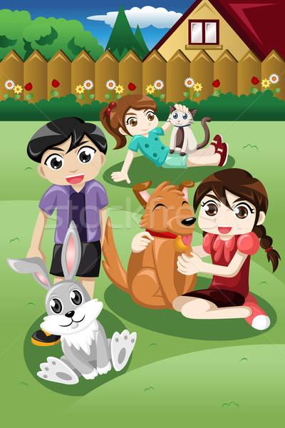 Kinderen spelen huisdieren kid spelen tuin glimlach Stockfoto © artisticco