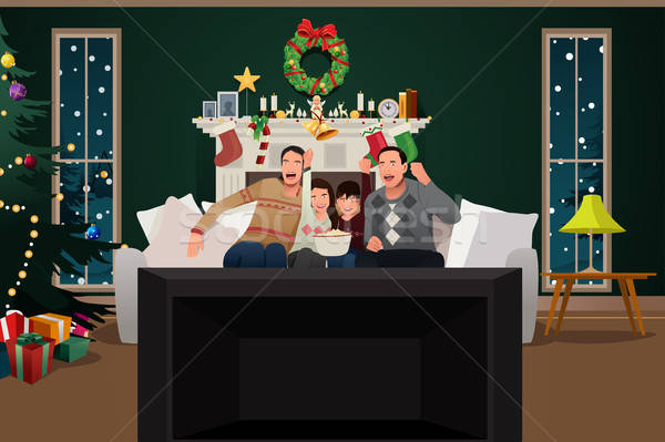 Family Watching TV During Christmas Season Stock photo © artisticco