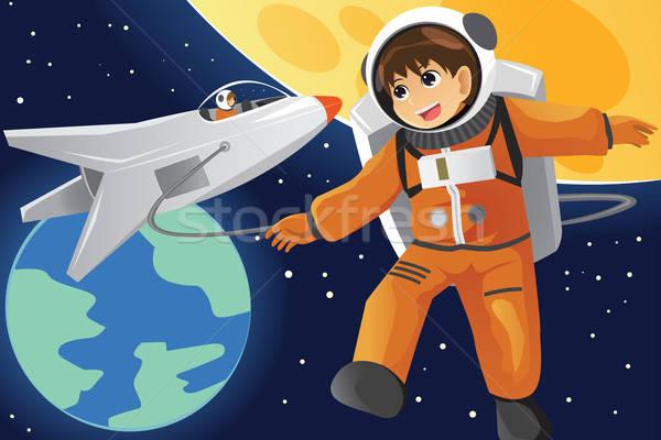 Kid imagining as an astronaut Stock photo © artisticco