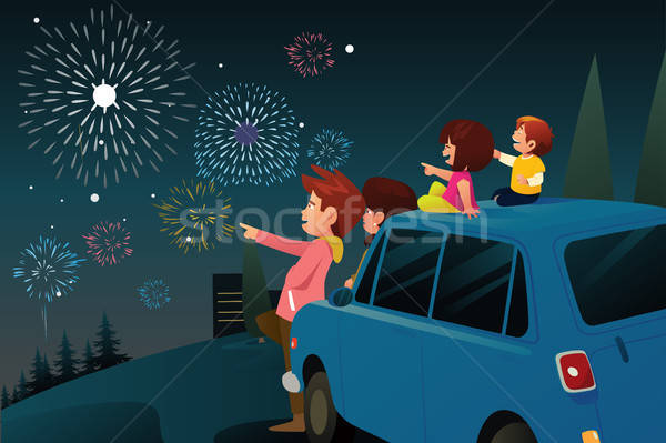 Family Watching Fireworks for New Year Celebration Stock photo © artisticco