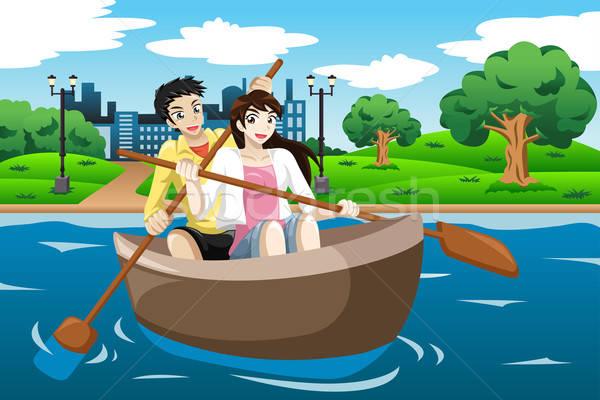 Gelukkig paar roeien boot meer vrouw Stockfoto © artisticco