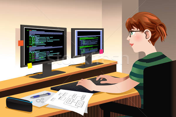 Female Programmer Coding on a Computer Stock photo © artisticco
