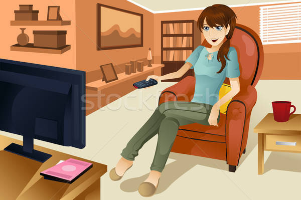 Woman watching television Stock photo © artisticco