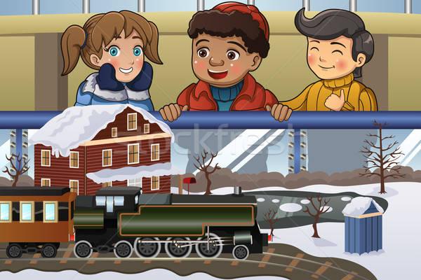 Gyerekek néz miniatűr vonat boldog modell Stock fotó © artisticco