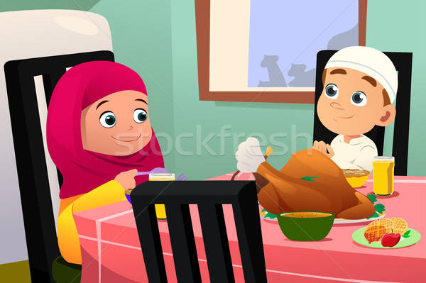 Muslim Children Eating At Dining Table Stock photo © artisticco