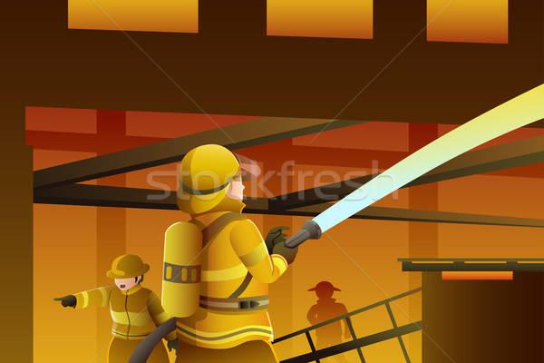 Bombeiros fora edifício fogo água homem Foto stock © artisticco