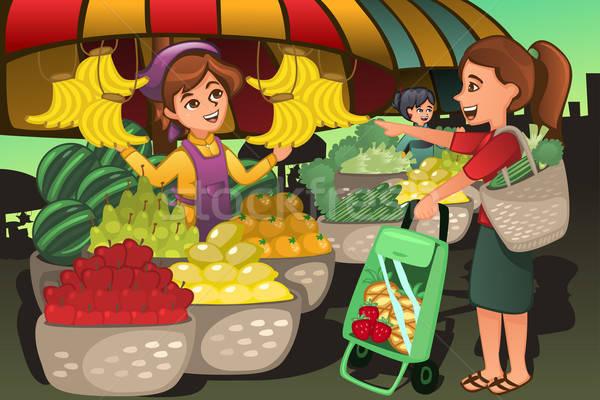 Frutas vendedor mercado cliente compras Foto stock © artisticco