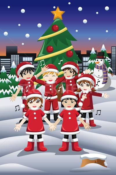 Kids Singing Christmas Carols Stock photo © artisticco