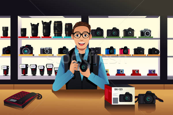 Store owner in a camera store Stock photo © artisticco