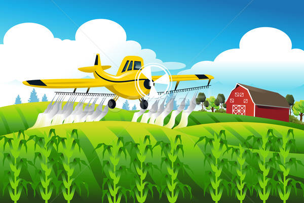 Crop duster flying over a field Stock photo © artisticco