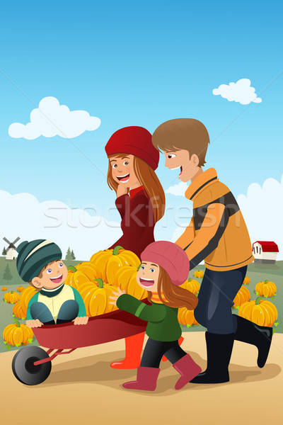 Kids and their parents on a pumpkin patch  Stock photo © artisticco