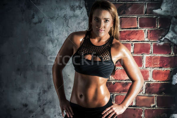 Female fitness model posing Stock photo © artistrobd