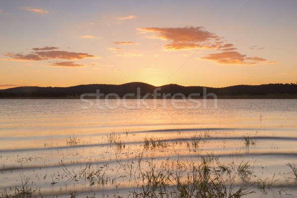 Meer queensland laat namiddag water wolken Stockfoto © artistrobd