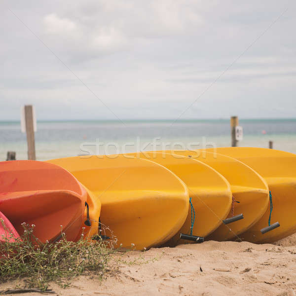 Kayaks on the beach during the day Stock photo © artistrobd