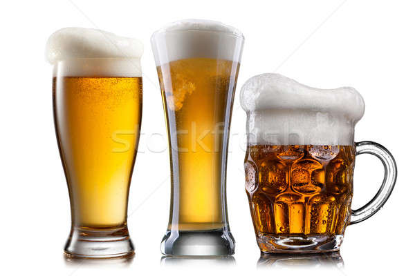 Beer in different glasses isolated on white background Stock photo © artjazz