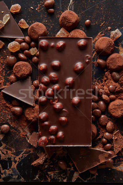 Chocolate and sweets isolated on black Stock photo © artjazz