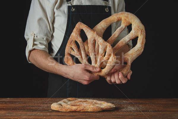 baker is holding fougas bread Stock photo © artjazz