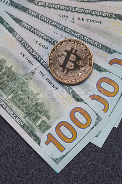 Gold coin bitcoin and new hundred dollar bills. Exchange of Crypto-Currency for Dollars Stock photo © artjazz