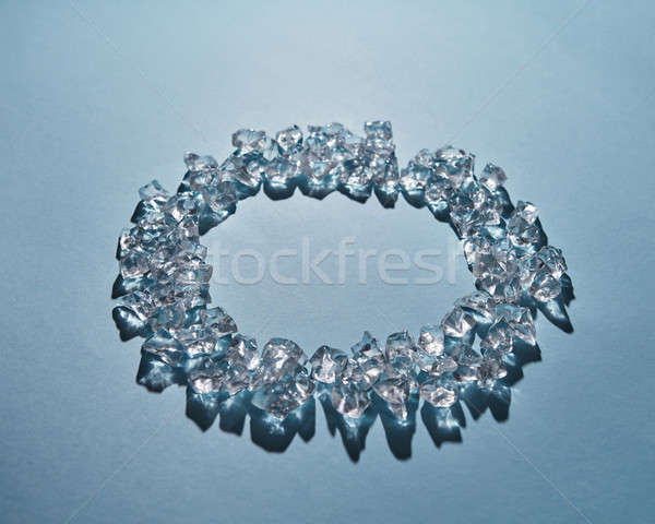 Round frame of pure ice cubes on a blue background Stock photo © artjazz