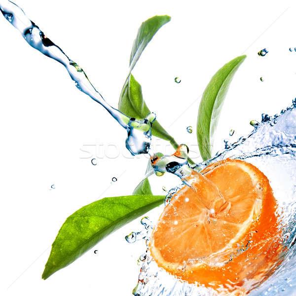 Stockfoto: Waterdruppels · oranje · groene · bladeren · geïsoleerd · druppels
