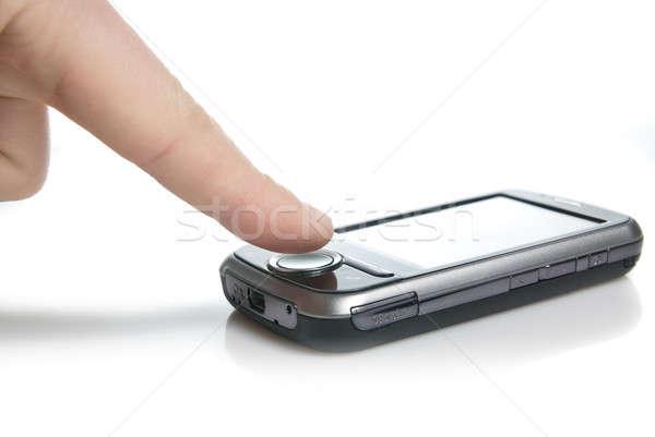 Ujj pda érintőképernyő izolált fehér kéz Stock fotó © artjazz