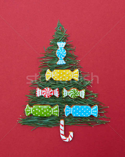 Christmas card with fir-tree needles and sweets of  cookies Stock photo © artjazz