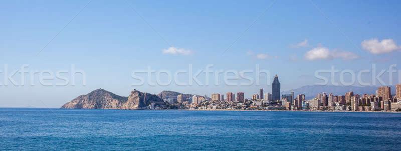 Cidade scape panorama arranha-céus praia nuvens Foto stock © artjazz