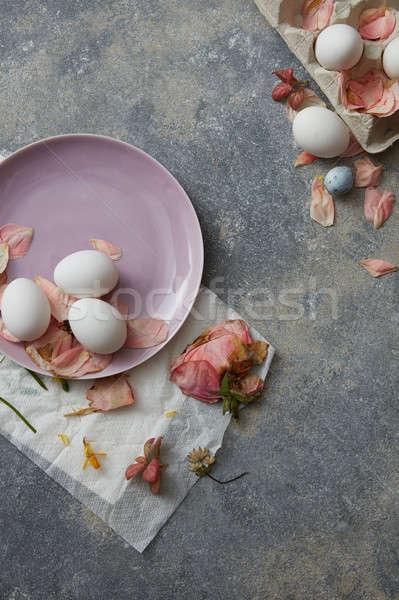 White eggs on pink plate Stock photo © artjazz