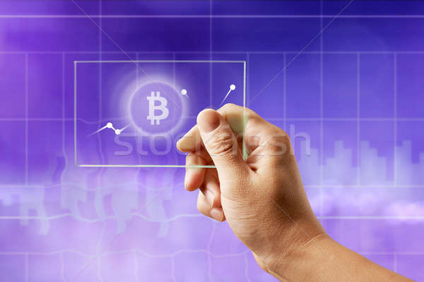 Icon bitcoin on a glass screen with a graph of crypto currency on an ultraviolet background Stock photo © artjazz