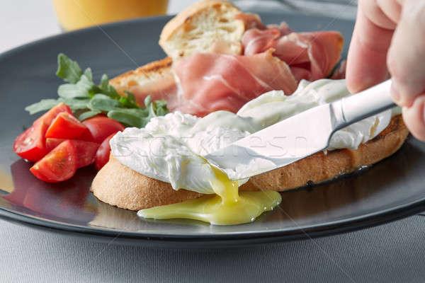 Benedict eggs on buttered wholemeal toast breakfast, Stock photo © artjazz