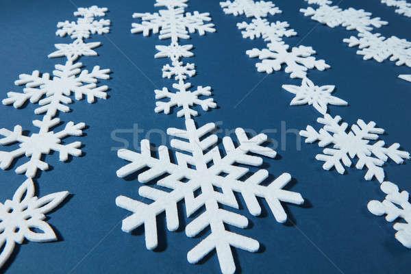 Płatki śniegu inny rząd niebieski zimą biały Zdjęcia stock © artjazz