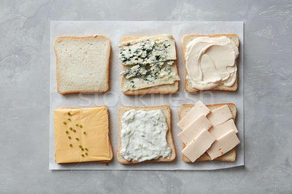 Pirított sajt kenyér darabok különböző pergamen Stock fotó © artjazz
