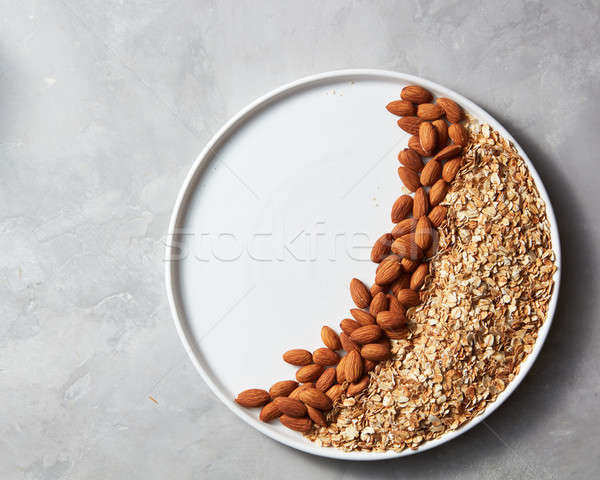 Ingredients for homemade oatmeal granola in a plate Stock photo © artjazz