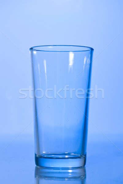 empty glass on blue Stock photo © artjazz