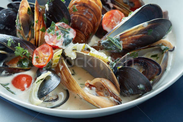 Stock photo: Mussels steamed just for eating in a blue dish