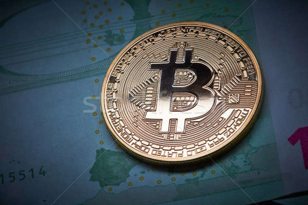 Bitcoin coins on Euro banknote as underground economy , Cryptocurrency concept photo Stock photo © artjazz