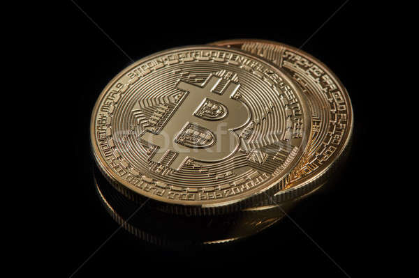 Stacked bitcoins the new modern currency for bitcoin payments on a black background Stock photo © artjazz