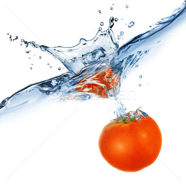 red tomato dropped into water isolated on white Stock photo © artjazz