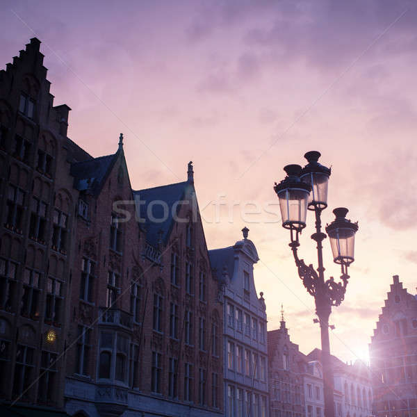 Stock photo: Silhouettes of city center houses in Bruges against beautiful su