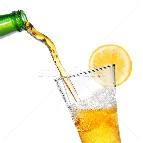Foto stock: Cerveja · garrafa · vidro · limão · isolado