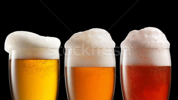 Different beer in glasses isolated on black Stock photo © artjazz
