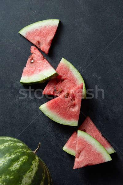 Anguria fette nero tavola acqua frutta Foto d'archivio © artjazz