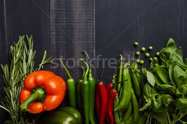 Healthy food background with fresh vegetables and hearbs on wooden table Stock photo © artjazz
