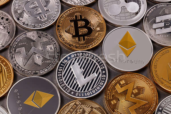 Many different coins of crypto currency on a dark background. Business and technology concept. Top v Stock photo © artjazz