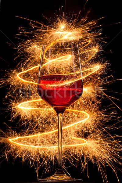 рюмку сжигание черный счастливым пить ночь Сток-фото © artjazz