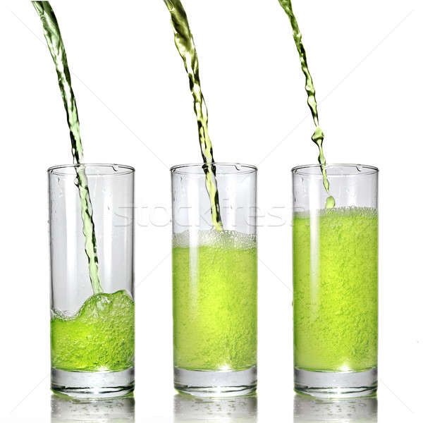 Stock photo: green juice pouring into glass isolated on white