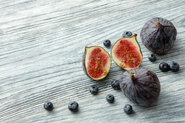 Fresh figs and blueberries Stock photo © artjazz