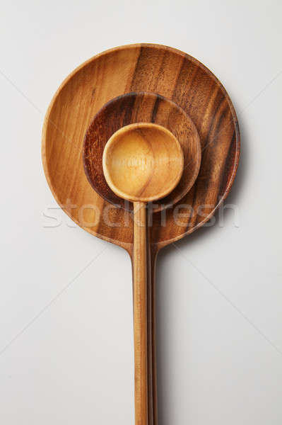 Wooden spoons of different sizes Stock photo © artjazz